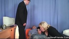 Two guys have fun with busty blonde granny