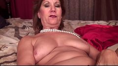 Mature lady Brook playing with shaved pussy