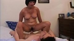 Glasses mature milf with young stud
