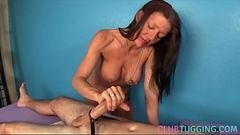 Busty milf gives handjob on a massage table